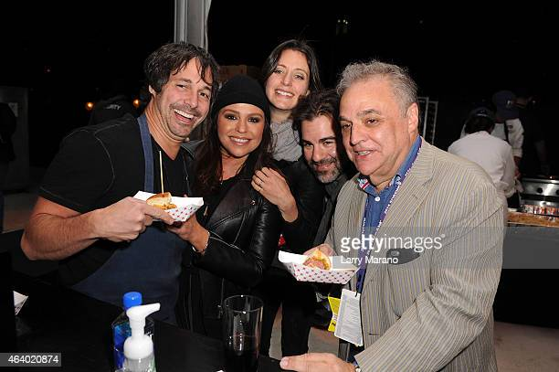 Ken Oringer Rachael Ray John Cusimano and founder and director of SOBEWFF Lee Brian Schrager attend the Amstel Light Burger Bash presented by Schweid...