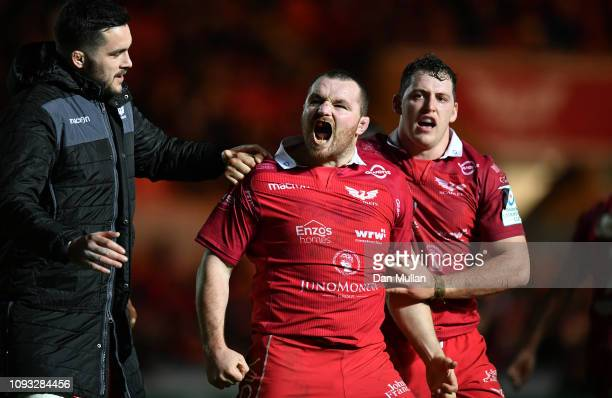 Ken Owens of Scarlets celebrates after scoring his side's second try during the Champions Cup match between Scarlets and Leicester Tigers at Parc y...