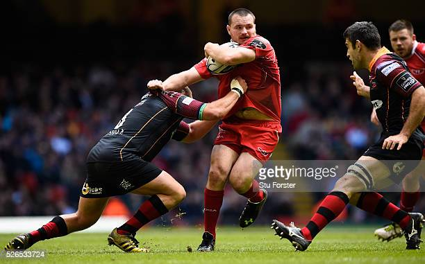 Ken Owens of the Scarlets breaks the tackle of Brok Harris of Newport during the Guinness Pro 12 match between Newport Gwent Dragons and Scarlets at...