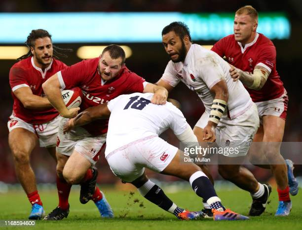 Ken Owens of Wales is tackled by Kyle Sinckler and Billy Vunipola of England during the Under Armour Summer Series match between Wales and England at...