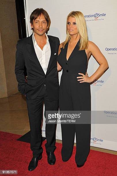 Ken Paves and Singer Jessica Simpson arrives at Operation Smile's 8th Annual Smile Gala at the Beverly Hills Hilton Hotel on October 2 2009 in...