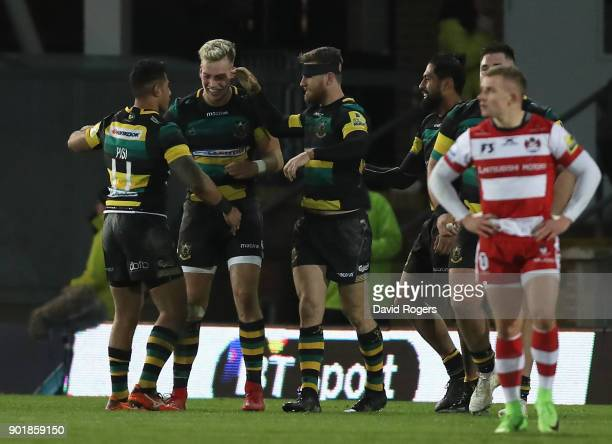 Ken Pisi Harry Mallinder Rob Horne of Northampton celebrate after their last minute victory during the Aviva Premiership match between Northampton...
