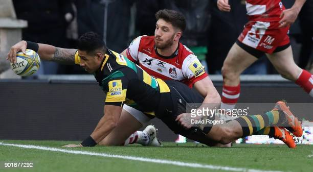 Ken Pisi of Northampton dives over for the first try during the Aviva Premiership match between Northampton Saints and Gloucester Rugby at Franklin's...