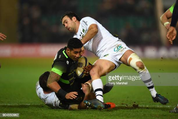 Ken Pisi of Northampton Saints is tackled by Alexandre Lapandry and Morgan Parra of ASM Clermont Auvergne during the European Rugby Champions Cup...