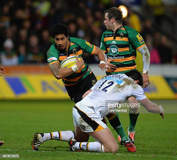 Ken Pisi of Northampton Saints is tackled by James Downey of Wasps during the Aviva Premiership match between Northampton Saints and Wasps at...