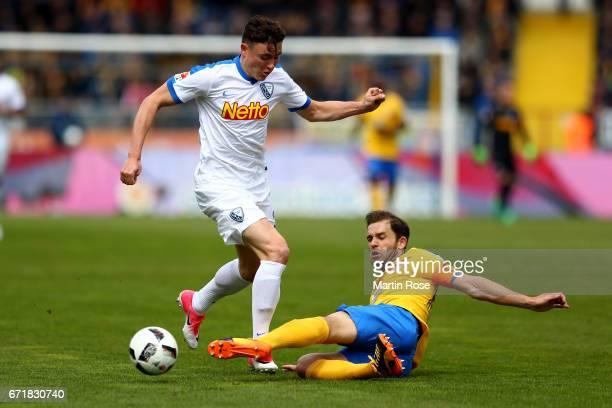 Ken Reichel of Braunschweig and Nils Quaschner of Bochum battle for the ball during the Second Bundesliga match between Eintracht Braunschweig and...