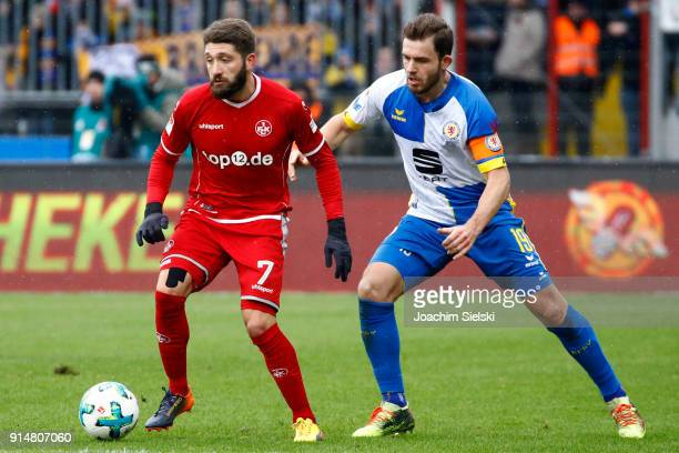 Ken Reichel of Braunschweig challenges Brandon Borrello of Kaiserslautern during the Second Bundesliga match between Eintracht Braunschweig and 1 FC...
