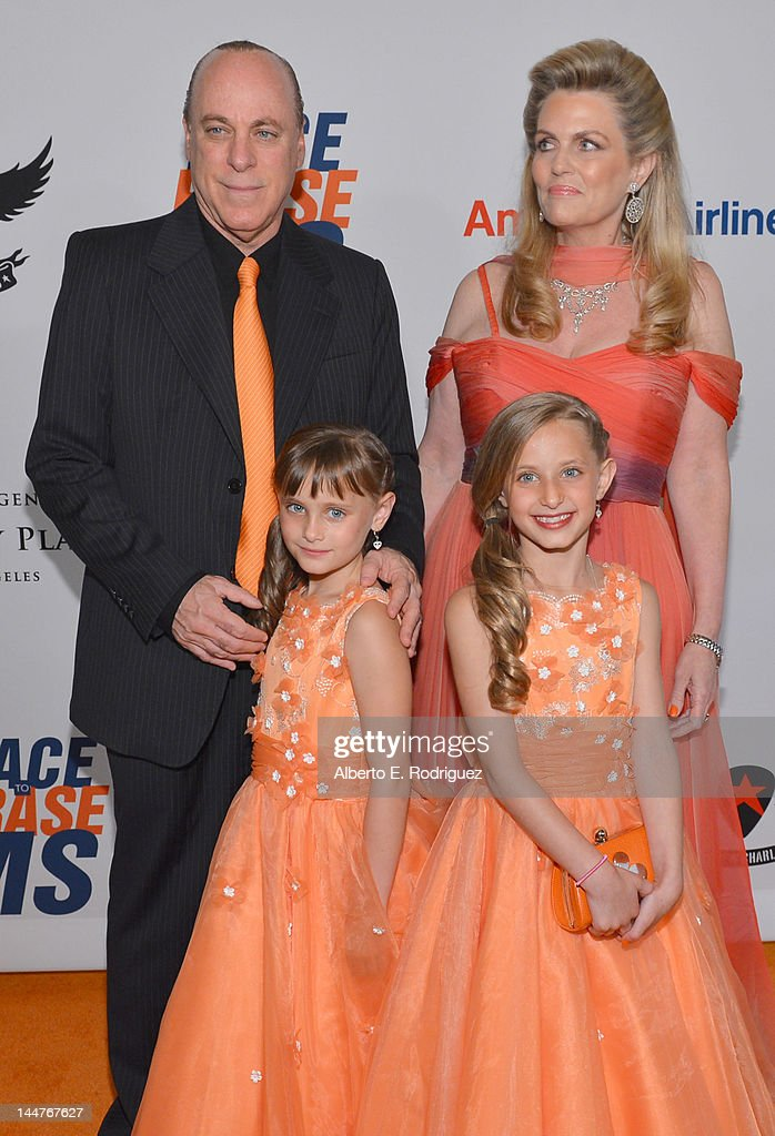 Ken Rickel, Nancy Davis, Isabella Rickel and Mariella Rickel arrive at the 19th Annual Race to Erase MS held at the Hyatt Regency Century Plaza on May 18, 2012 in Century City, California.