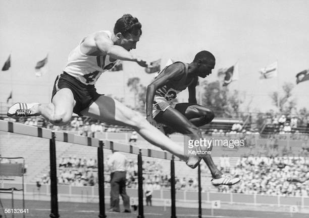 Ken Roche of Australia and Kimaru Songok of Kenya clear the last hurdle in the 440 yards men's hurdles event at the British Empire and Commonwealth...