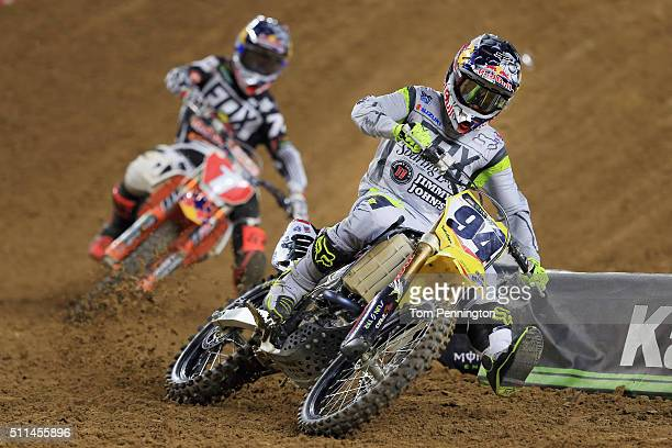 Ken Roczen rider of the Suzuki RM-Z450 leads Ryan Dungey rider of the KTM 450 SX-F Factory Edition into a corner during the 450SX Main during the...