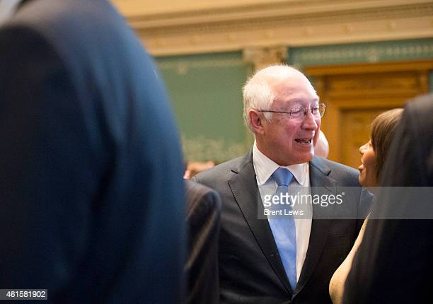 Ken Salazar talks with people while waiting for the start of the State of the State address Thursday January 15 2015 at the Colorado State Capitol...