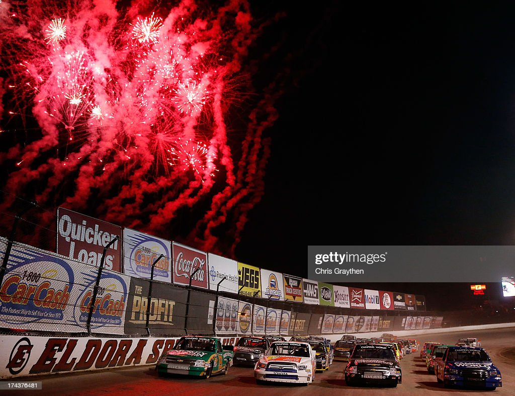 Ken Schrader, driver of the #52 Federated Auto Parts Toyota, leads the field as they line up four wide during the NASCAR Camping World Truck Series inaugural CarCash Mudsummer Classic at Eldora Speedway on July 24, 2013 in Rossburg, Ohio.