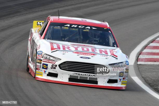 Ken Schrader Ford Fusion drives through turn four during the practice session for the ARCA Racing Series PapaNicholas Coffee 150 on June 22nd at...