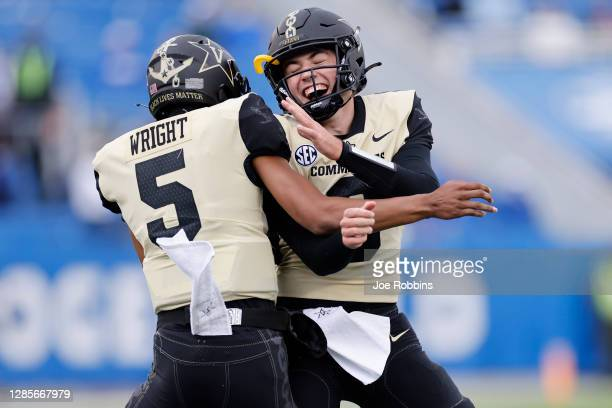 Ken Seals and Mike Wright of the Vanderbilt Commodores celebrate after a touchdown against the Kentucky Wildcats in the second quarter of the game at...