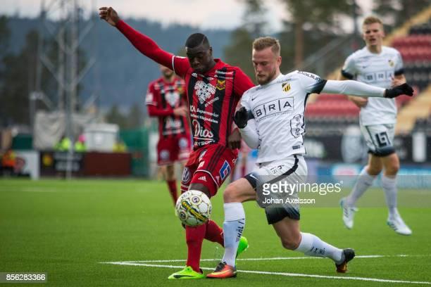 Ken Sema of Ostersunds FK and Alexander Faltsetas of BK Hacken competes for the ball during the Allsvenskan match between Ostersunds FK and BK Hacken...