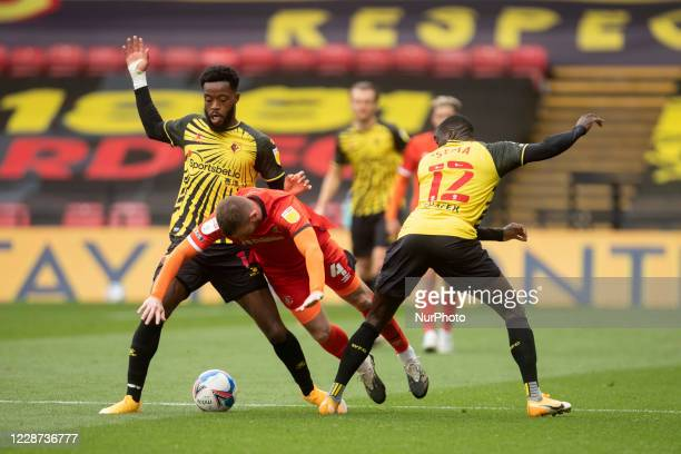 Ken Sema of Watford and Ryan Tunnicliffe of Luton Town during the Sky Bet Championship match between Watford and Luton Town at Vicarage Road Watford...
