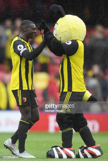 Ken Sema of Watford celebrates victory with mascot Harry the Hornet following the Premier League match between Watford FC and Crystal Palace at...