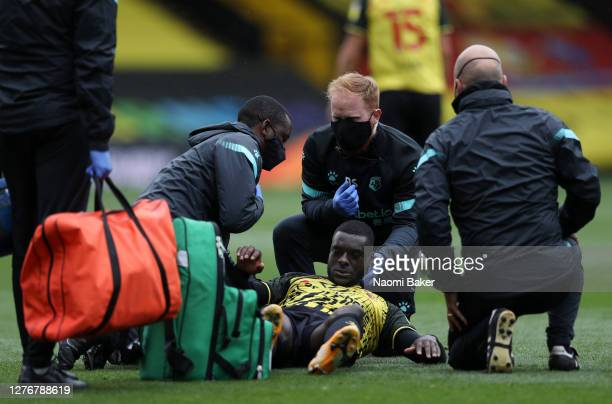 Ken Sema of Watford receives medical treatment during the Sky Bet Championship match between Watford and Luton Town at Vicarage Road on September 26...