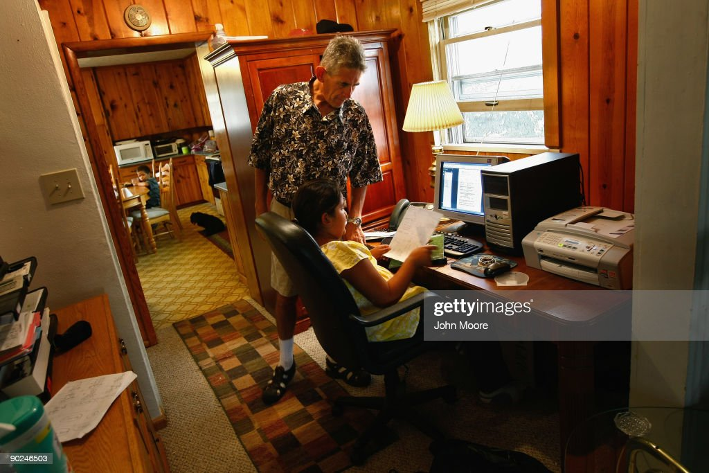 Ken Sheel, terminally ill with pancreatic cancer, checks his daughter Tiffany's homework at their home on August 31, 2009 in Denver, Colorado. The non-profit Hospice of Saint John serves an average of 200 people at any given time, most of them homecare patients. The hospice accepts patients regardless of their ability to pay, although most are covered by Medicare or Medicaid. The goal of the center is to maintain quality of life, manage pain, and offer spiritual guidance for residents in the last stage of their lives. End of life care has become a contentious issue in the current national debate on health care reform.