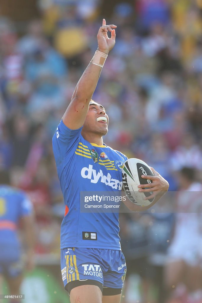 Ken Sio of the Eels celebrates scoring a try during the round 10 NRL match between the Parramatta Eels and the St George Illawarra Dragons at Pirtek Stadium on May 17, 2014 in Sydney, Australia.