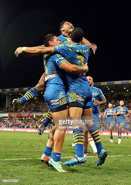 Ken Sio of the Eels celebrates with team mate Will Hopoate and Chris Sandow after scoring a try during the round 6 NRL match between the Parramatta...