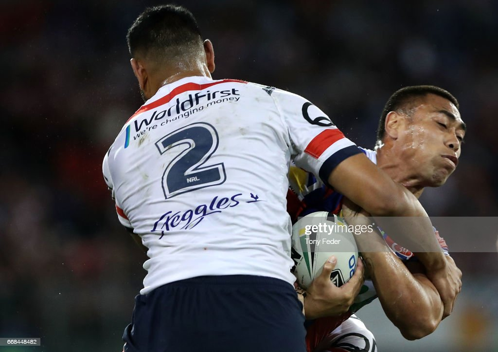 Ken Sio of the Knights is tackled by Daniel Tupou of the Roosters during the round seven NRL match between the Newcastle Knights and the Sydney Roosters at McDonald Jones Stadium on April 14, 2017 in Newcastle, Australia.