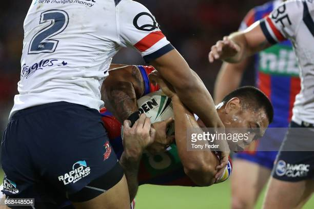 Ken Sio of the Knights is tackled by Daniel Tupou of the Roosters during the round seven NRL match between the Newcastle Knights and the Sydney...