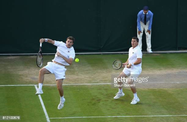 Ken Skupski and Neal Skupski of Great Britain in action in their Gentlemen's Doubles third round match against Marcus Daniell of New Zealand and...