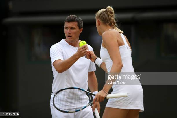 Ken Skupski of Great Britain and Jocelyn Rae of Great Britain celebrate a point during the Mixed Doubles third round match against Ekaterina Makarova...
