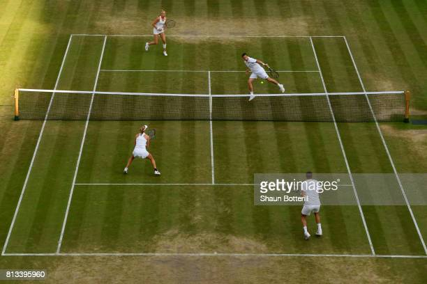 Ken Skupski of Great Britain and Jocelyn Rae of Great Britain and Ekaterina Makarova of Russia and Max Mirnyi of Belarus in action during the Mixed...