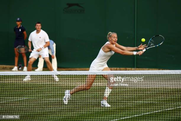 Ken Skupski of Great Britain and Jocelyn Rae of Great Britain in action during the Mixed Doubles first round match against Divij Sharan of India and...