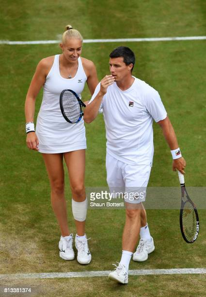 Ken Skupski of Great Britain and Jocelyn Rae of Great Britain in discussion during the Mixed Doubles third round match against Ekaterina Makarova of...