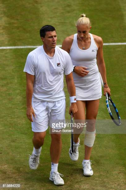 Ken Skupski of Great Britain and Jocelyn Rae of Great Britain of Switzerland in discussion during the Mixed Doubles quarter final match against Jamie...