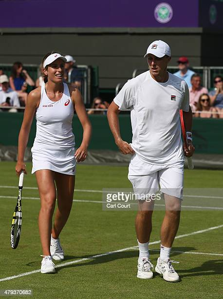 Ken Skupski of Great Britain and Johanna Konta of Great Britain talk tactics in their Mixed Doubles First Round match against Aisam Qureshi of...