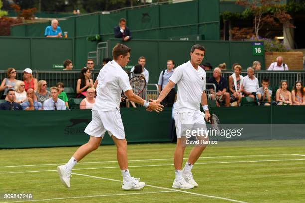 Ken Skupski of Great Britain and Neal Skupski of Great Britain celebrate a point during the Gentlemen's Doubles first round match against Brydan...