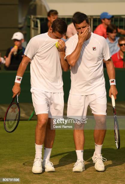 Ken Skupski of Great Britain and Neal Skupski of Great Britain in discussion during the Gentlemen's Doubles first round match against Brydan Klein of...