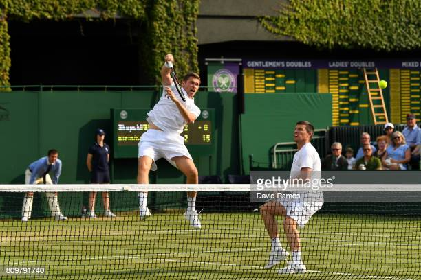 Ken Skupski of Great Britain and Neal Skupski of Great Britain in action during the Gentlemen's Doubles first round match against Brydan Klein of...