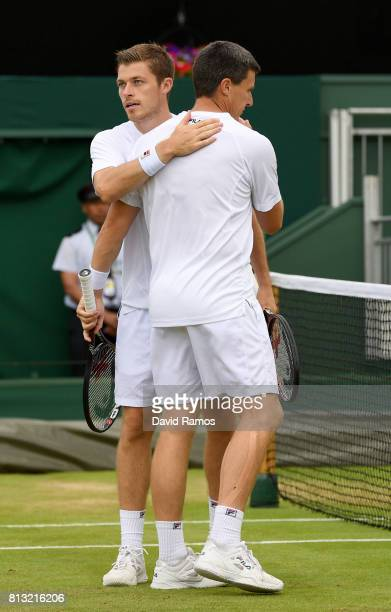 Ken Skupski of Great Britain and Neal Skupski of Great Britain embrace in defeat after the Gentlemen's Doubles quarter final match against Lukasz...