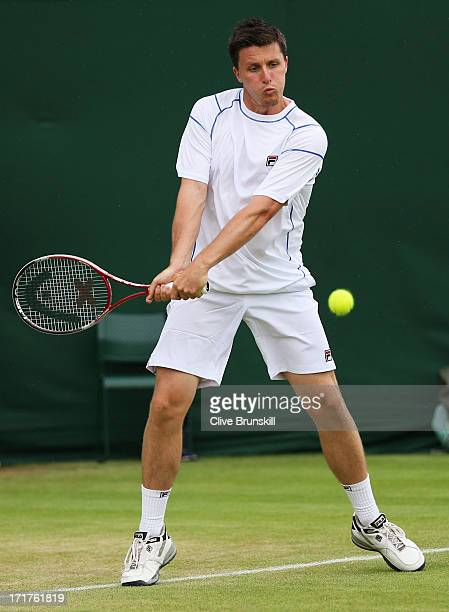 Ken Skupski of Great Britain hits a backhand during the Gentlemen's Doubles second round match against Aisam Qureshi of Pakistan and JeanJulien Rojer...