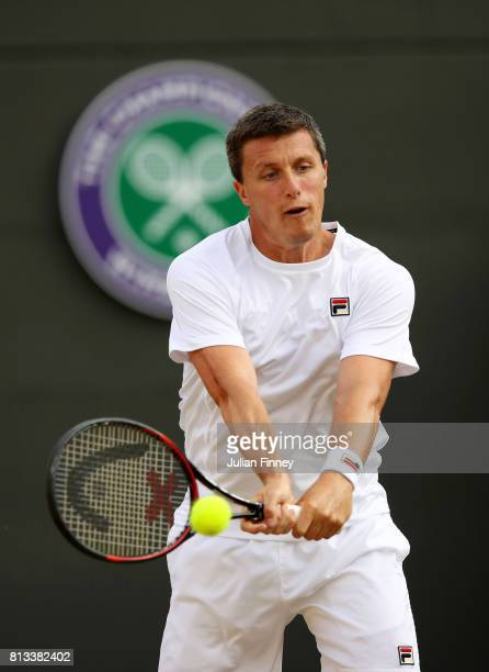 Ken Skupski of Great Britain plays a backhand during the Mixed Doubles third round match against Ekaterina Makarova of Russia and Max Mirnyi of...