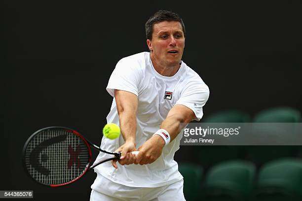 Ken Skupski of Great Britain plays a forehand during the Men's Singles first round match against Oliver Marach of Austria and Fabrice Martin of...
