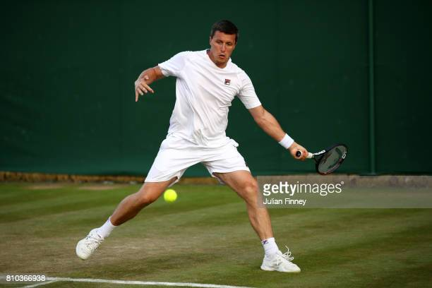 Ken Skupski of Great Britain plays a forehand during the Mixed Doubles first round match against Divij Sharan of India and Zhaoxuan Yang of China on...