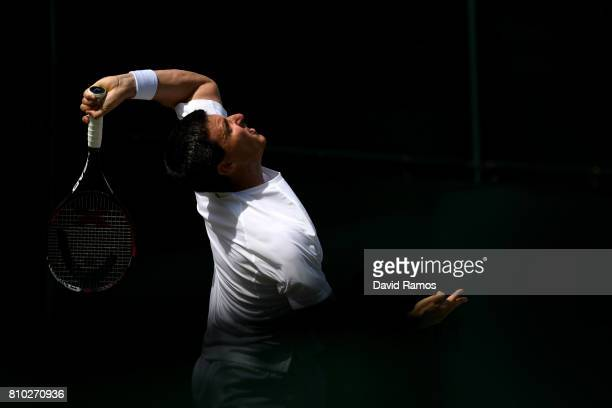 Ken Skupski of Great Britain serves during the Gentlemen's Doubles second round match against Rohan Bopanna of India and Edouard RogerVasselin of...