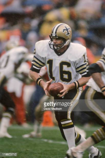 Ken Stabler of the New Orleans Saints prepares to hand off during a rainy National Football League game against the San Francisco 49ers played on...