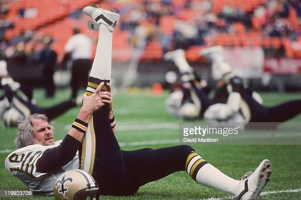 Ken Stabler of the New Orleans Saints stretches on the field prior to a National Football League game against the San Francisco 49ers played on...