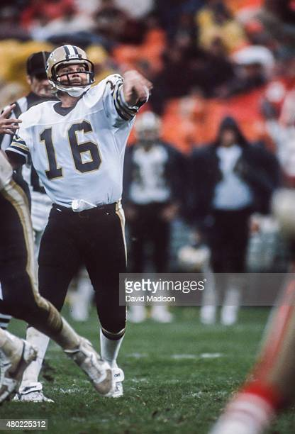 Ken Stabler of the New Orleans Saints throws a pass during a rainy National Football League game against the San Francisco 49ers played on November...