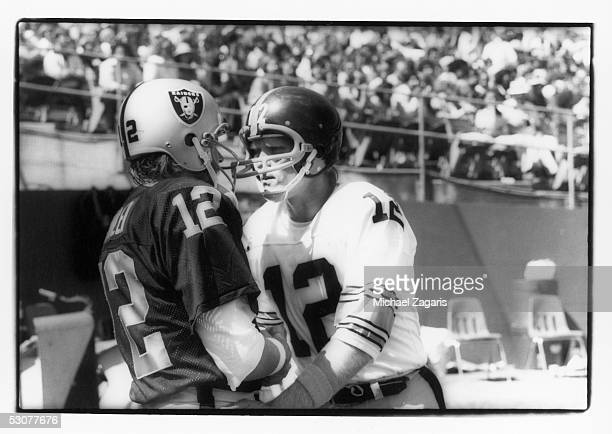 Ken Stabler of the Oakland Raiders greets Terry Bradshaw of the Pittsburgh Steelers before the game at the Oakland Alameda Coliseum on September 12...