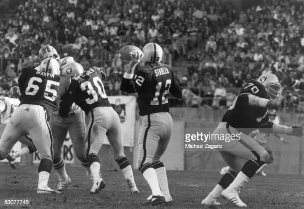Ken Stabler of the Oakland Raiders looks to pass during the game against the San Diego Chargers at Oakland Alameda Coliseum on October 29 1978 in...