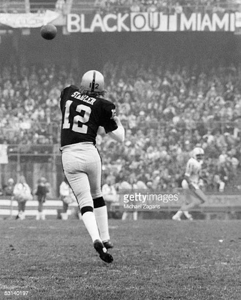 Ken Stabler of the Oakland Raiders throws a pass against the Miami Dolphins during the 1974 AFC Divisional Playoff game at Oakland Alameda Coliseum...