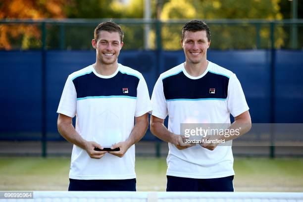 Ken Supski and Neal Skupski of Great Britain pose with their trophies after victory in their Men's Doubles Final match against Matt Reid and...